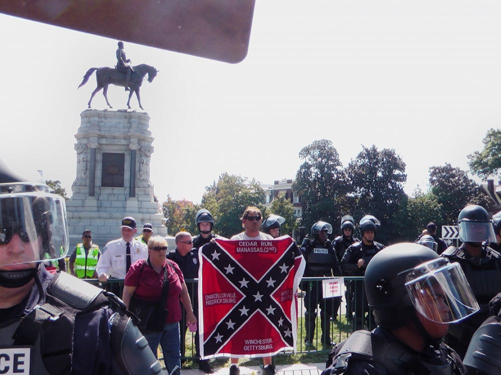 Protesters and counter-protesters alike gathered around the Robert E. Lee statue on Monument Avenue Saturday when members of a Tennessee-based pro-Confederate group arrived in Richmond and rallied in its defense.