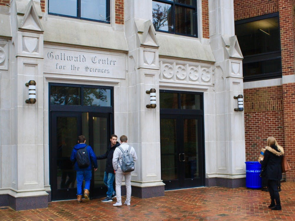<p>Students enter the Gottwald Science Center, home to the chemistry department.&nbsp;</p>