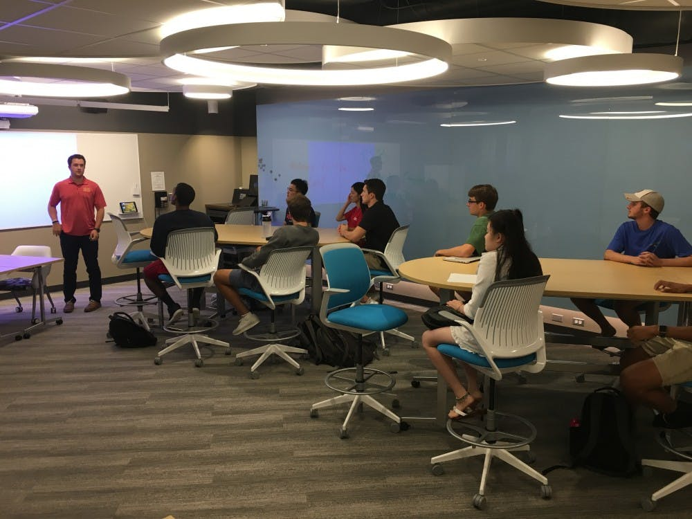 Cole Hurford, junior, president of the entrepreneurship club, leads a club meeting in the business school's new iLab.