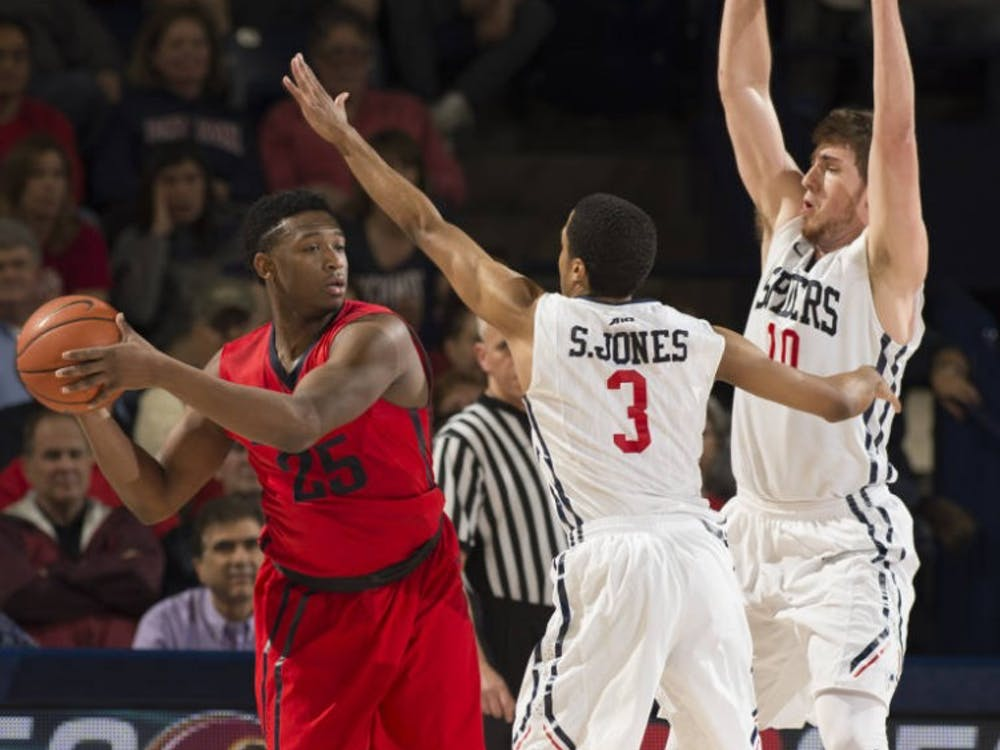 ShawDre' Jones and TJ Cline defend Dayton's Kendall Pollard, who helped the Flyers to a victory against the Spiders in the A-10 Quarterfinals| Photo courtesy of Richmond Athletics