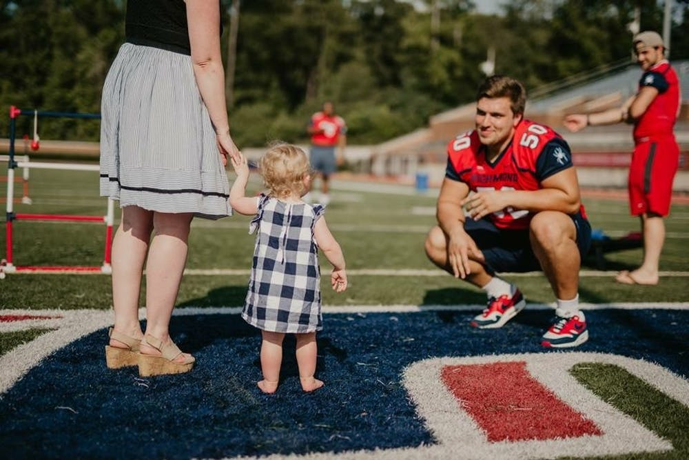 <p>Yarbrough greets one of his fans at the annual Fan Fest this past summer at Robins Stadium. <em>Photo courtesy of Richmond Athletics.</em></p>
