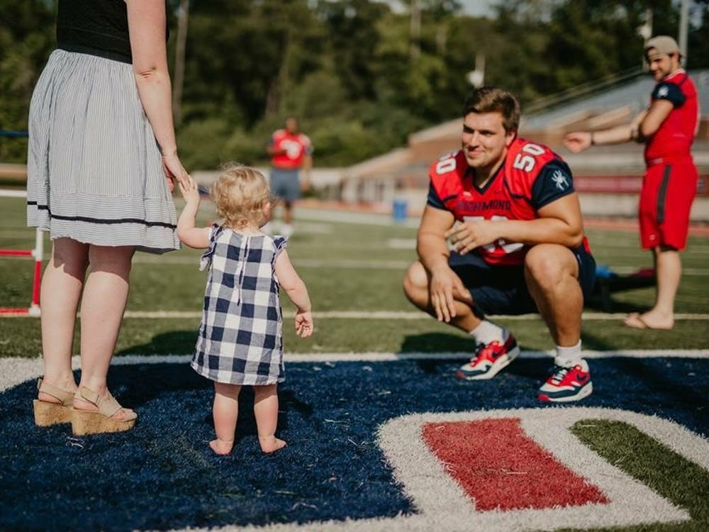 Yarbrough greets one of his fans at the annual Fan Fest this past summer at Robins Stadium. Photo courtesy of Richmond Athletics.