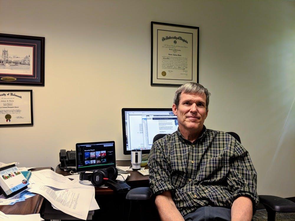 Mathematics professor James Davis sits in his office.