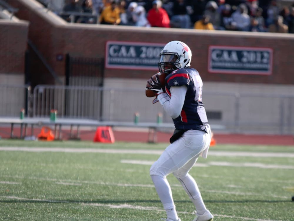 Quarterback Kevin Johnson led the Spiders to a playoff win in his first career start on Saturday.