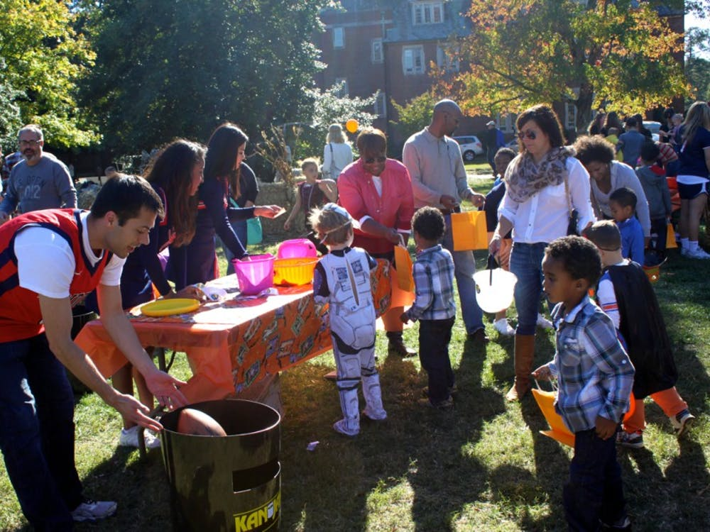 Richmond students and local families enjoy games at candy during Trick or Treat Street (TOTS) on the Westhampton Green.