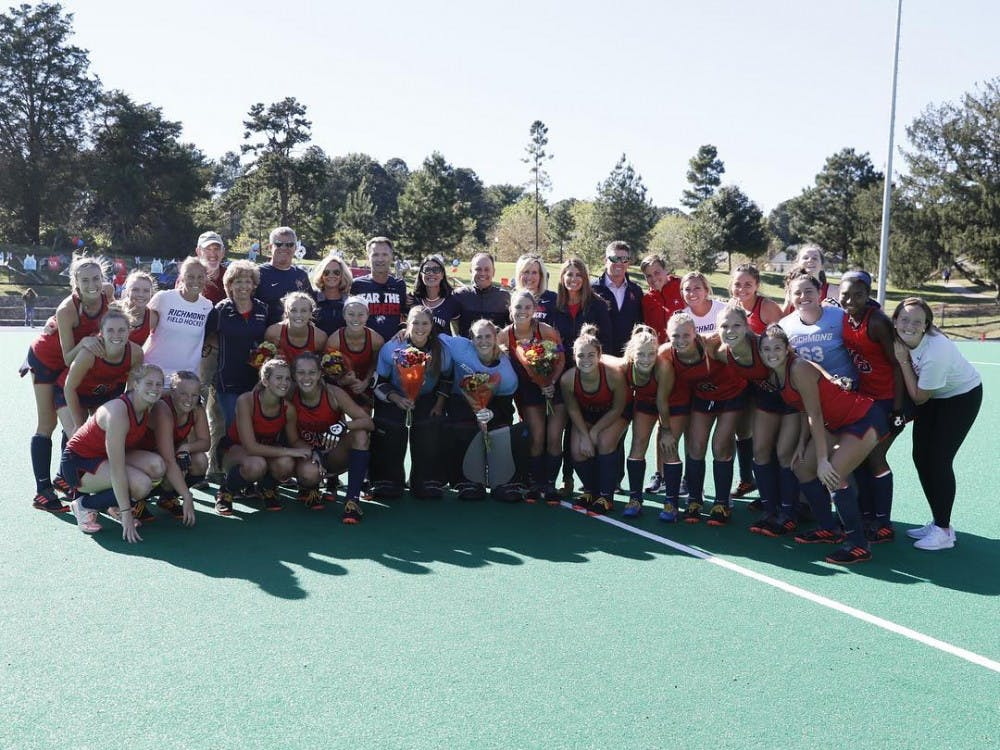 The University of Richmond field hockey team celebrates their senior day after a 2-0 win over Davidson on October 19th. Photo courtesy of Spider Field Hockey Instagram.