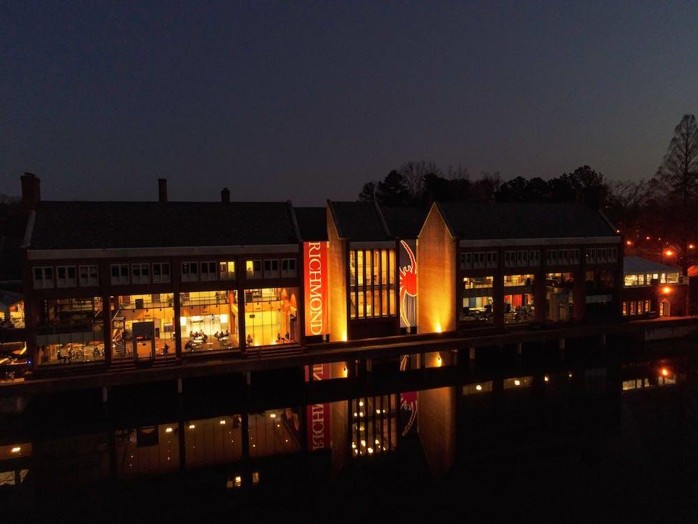 <p>Tyler Haynes Commons shines its reflection onto Westhampton lake.</p>