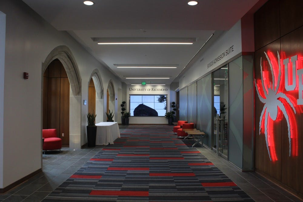 <p>Carpets throughout the Queally Center for Admission and Career Services supports the University of Richmond's red and blue colors.</p>