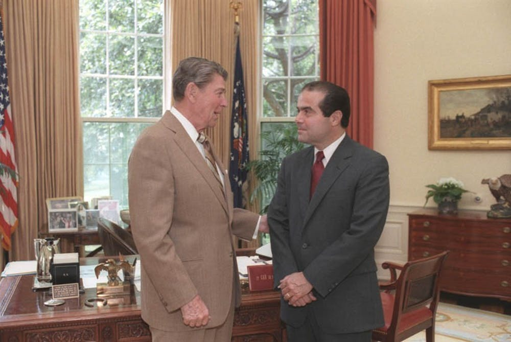 president_ronald_reagan_and_judge_antonin_scalia_confer_in_the_oval_office_july_7_1986