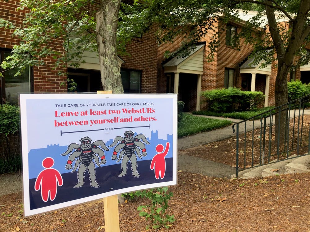 A sign located outside the University Forest Apartments reminds students to adhere to social distancing guidelines.