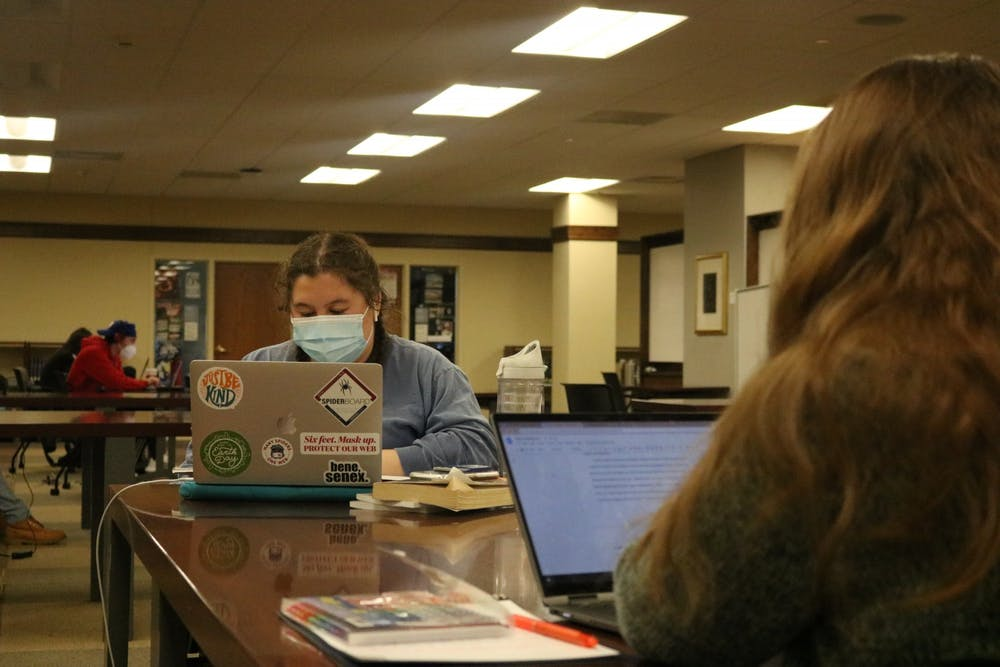 <p>Two students work across from each other in Boatwright Memorial Library.</p>