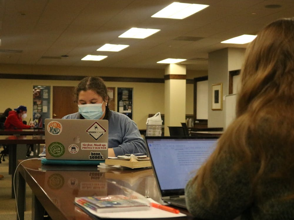 Two students work across from each other in Boatwright Memorial Library.