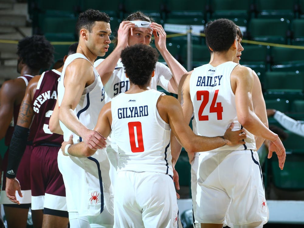 Richmond Spiders' guard Jacob Gilyard gathers his team in a huddle during the National Invitation Tournament quarterfinals at the UNT Coliseum on Thursday, Mar. 26, 2021. Photo courtesy of the NCAA