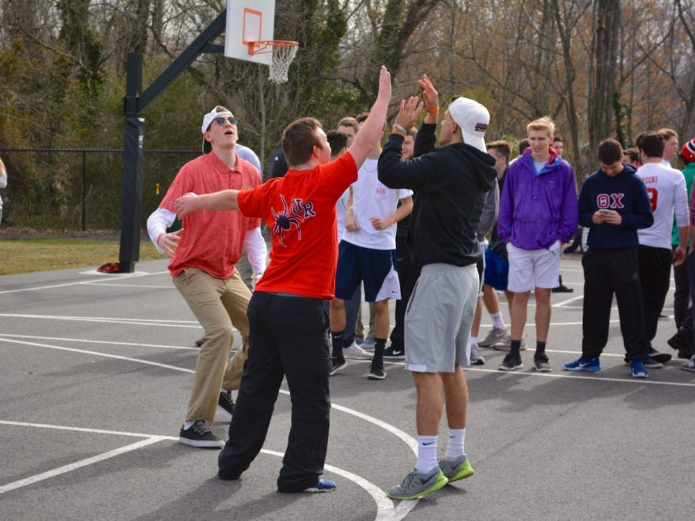 Students and Buddies played a friendly game ofbasketball.