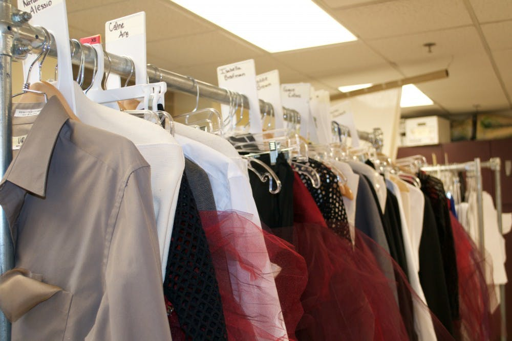 <p>Each costume is handmade then organized into racks by dancer.</p>