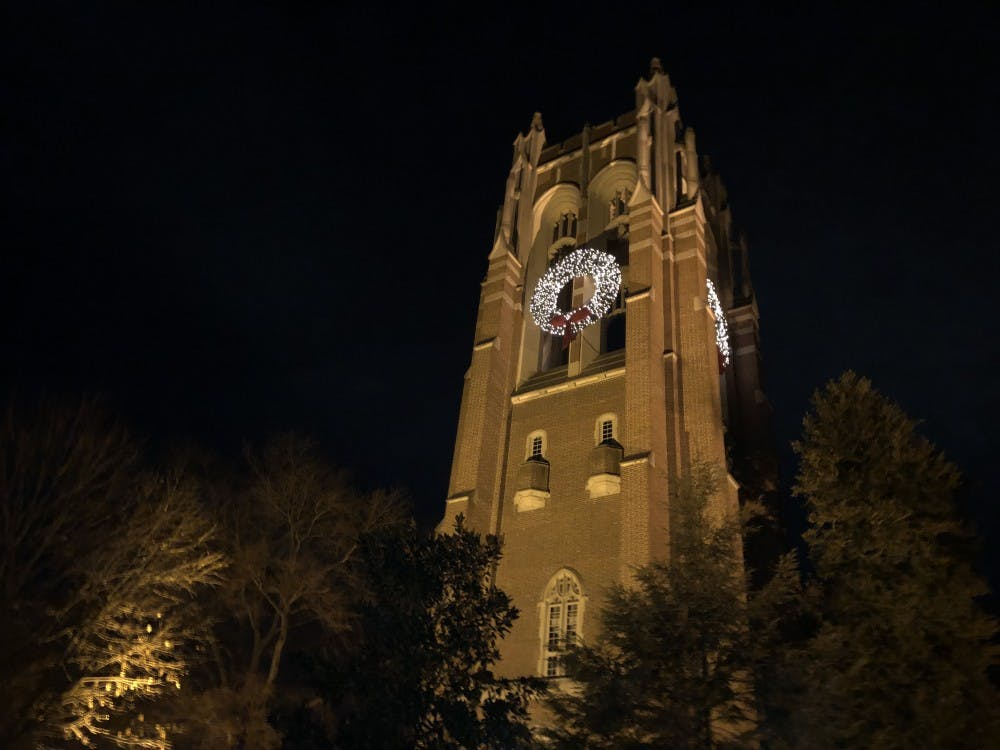 The wreaths illuminated at night on Boatwright Memorial Library.