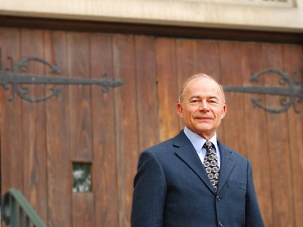 Bob Schmidt, interim dean of the busines school, poses for a portrait outside the entrance to the Robins School of Business. Time: 9:30 am, Saturday