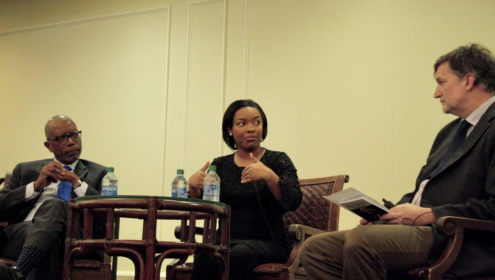 <p>Michael Paul Williams, Ayesha Rascoe and Thad Williamson discuss the intersection of truth and journalism in the Jepson Alumni Center.&nbsp;</p>