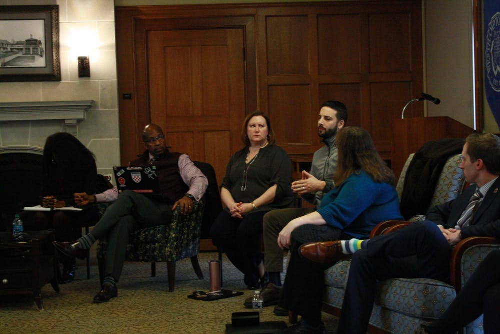 <p>Keith McIntosh (left) listens as his colleague talks during an Intersection meeting on Jan. 29.&nbsp;</p>