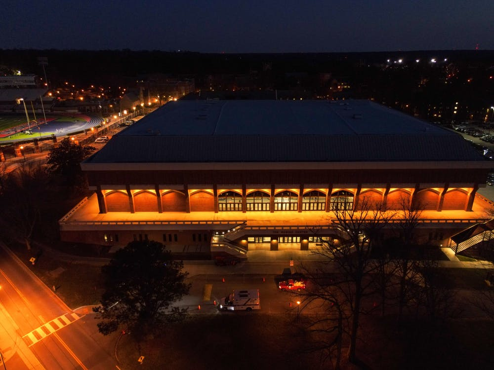 <p>Robins Arena emits a calm glow on the first night of the A10 tournament.</p>