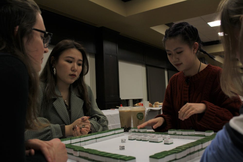 <p>Reilly Geritz (L), Yanran Li and Nicole Liu play Mahjong at the Lunar New Year celebration.</p>