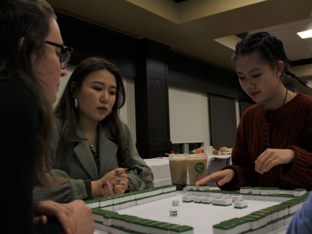 Reilly Geritz (L), Yanran Li and Nicole Liu play Mahjong at the Lunar New Year celebration.