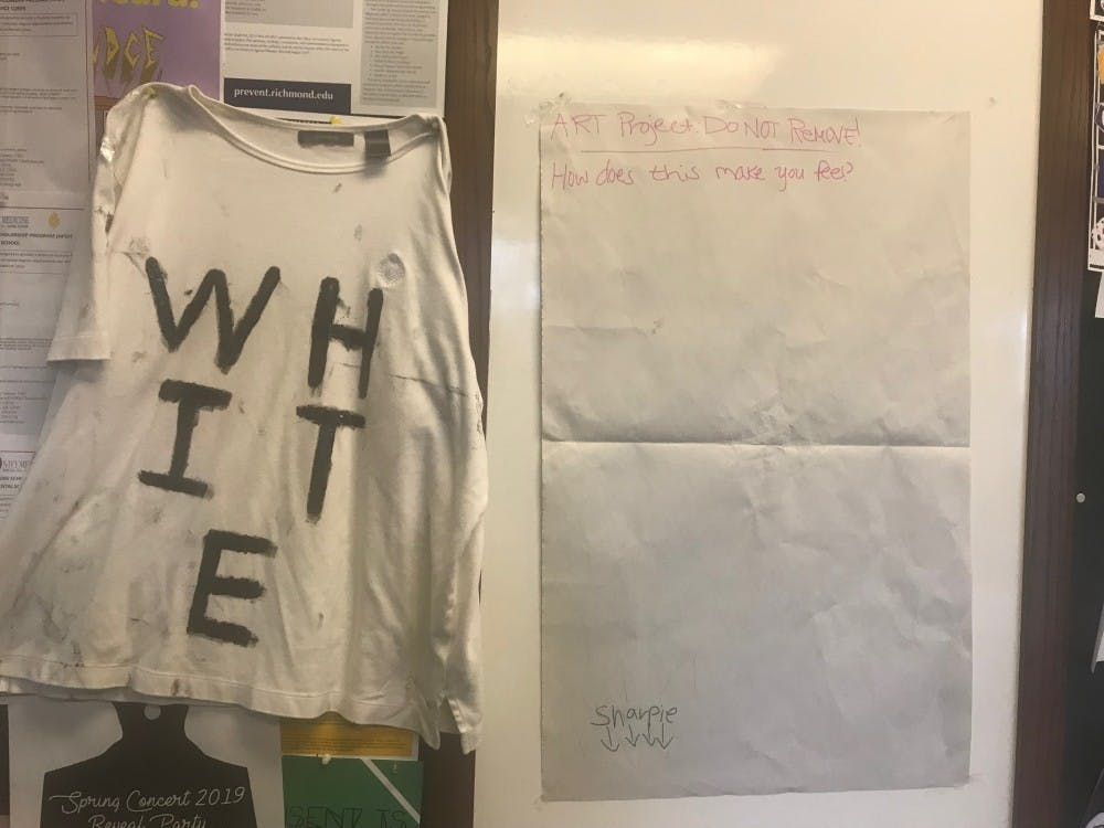 <p>One of the pieces in Kidest Gebre's art project, which involved using white shirts as canvases for political discourse. <em>Photo courtesy of Kidest Gebre.</em></p>