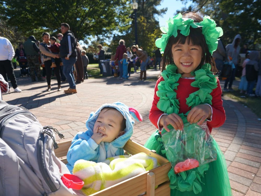 Children came to the event in costumes, like these two sisters dressed as Lilo (right) and Stitch.