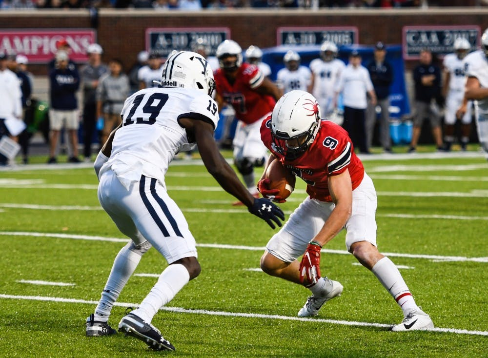 Graduate student wide receiver Charlie Fessler is blocked by Yale defense during a game at Robins Stadium on Saturday, October 19, 2019.
