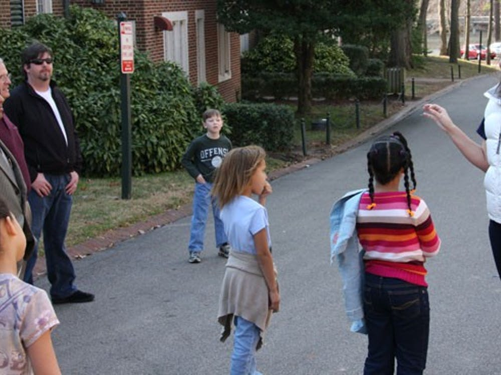 Caroline Vincent, '11, begins a tour around campus for the children