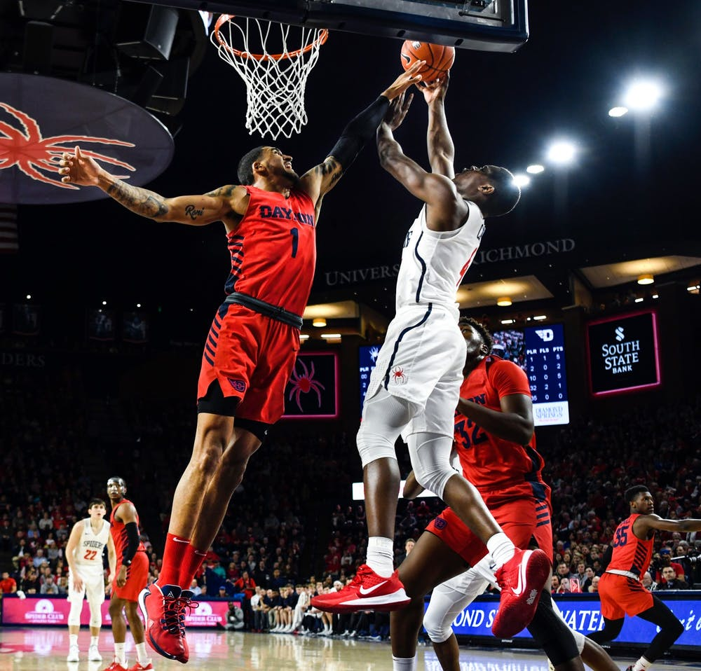 <p>The Dayton Flyers' forward Obadiah Toppin attempts to block a shot by the Richmond Spiders' forward Nathan Cayo during a game at the Robins Center on Saturday, Jan. 25, 2020.&nbsp;</p>