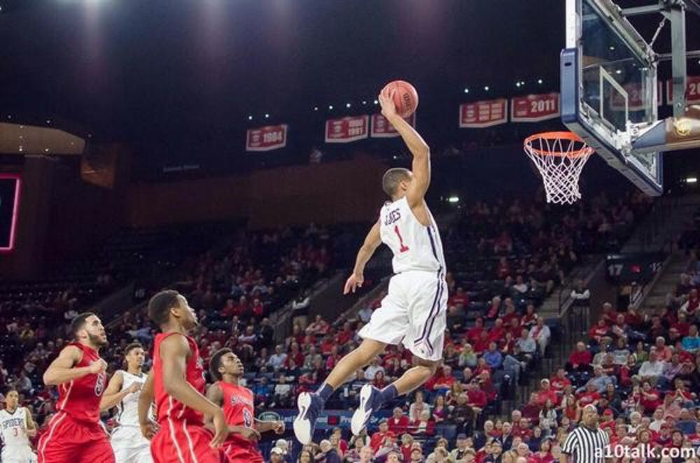 <p>Josh Jones electrifies the Robins Center crowd with a fastbreak dunk. His dunk was the subject of numerous tweets, which included pictures and videos of the play.</p>