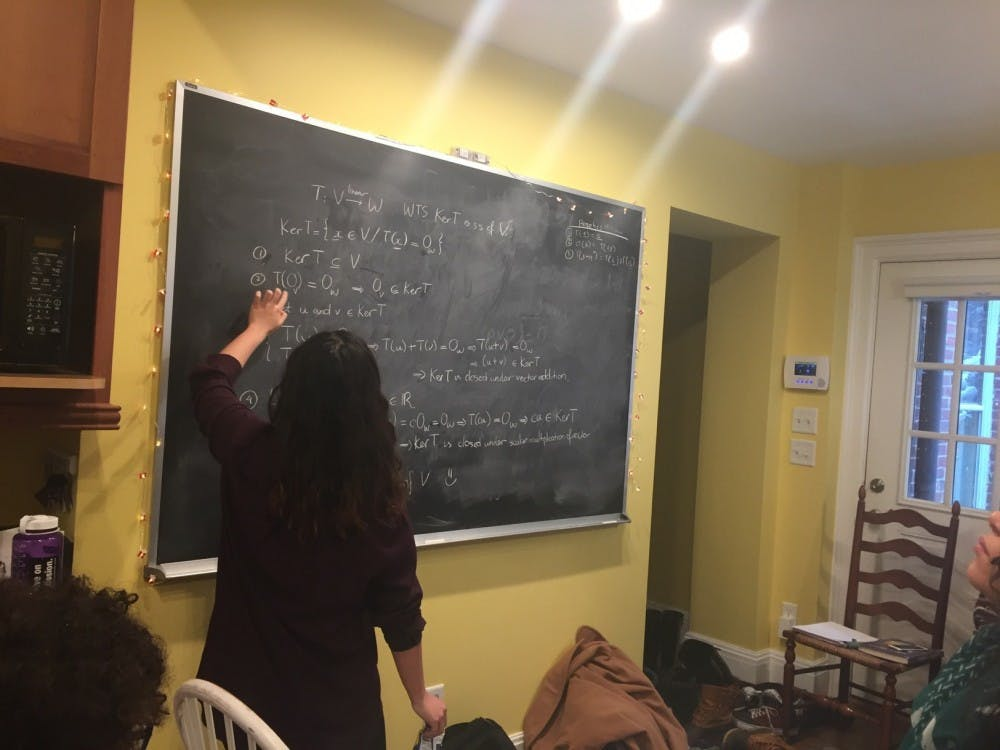 <p>Professor Della Dumbaugh has a chalkboard in her kitchen for students to work on problems. <em>Photo courtesy of Della Dumbaugh.&nbsp;</em></p>