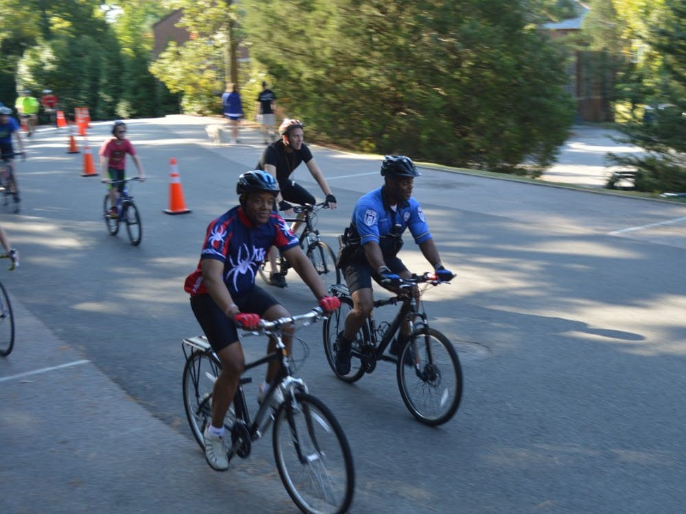 Ronald Crutcher, university president, led dozens of riders around Richmond's campus for the first Presidential 5K Bike Ride, kicking off spirit week that will lead up to Sunday's big race. Photos by Jack Nicholson.