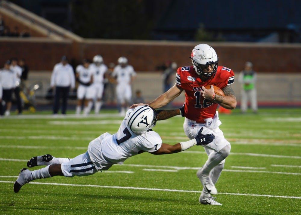 Redshirt junior quarterback Joe Mancuso evades Yale defense.