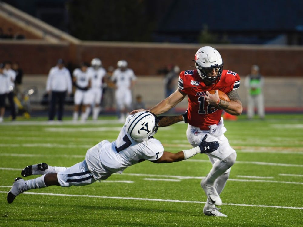 Redshirt junior quarterback Joe Mancuso evades Yale defense.