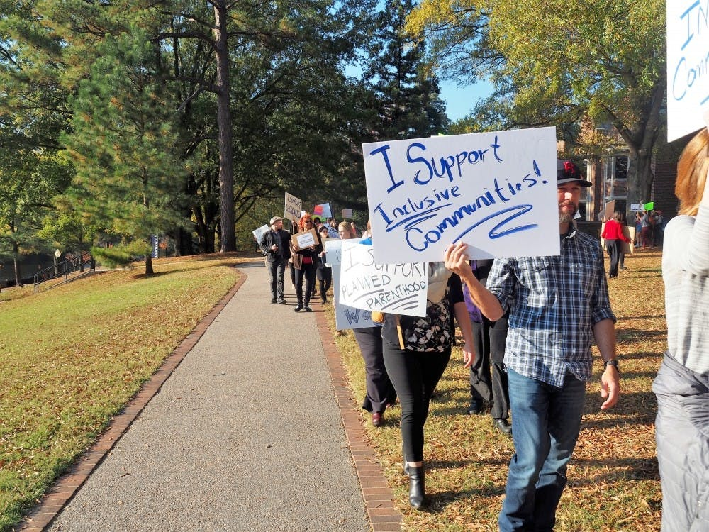 <p>Students, faculty and staff organized outside Boatwright Memorial Library on Nov. 16, 2016 to positively protest the presidential election.</p>