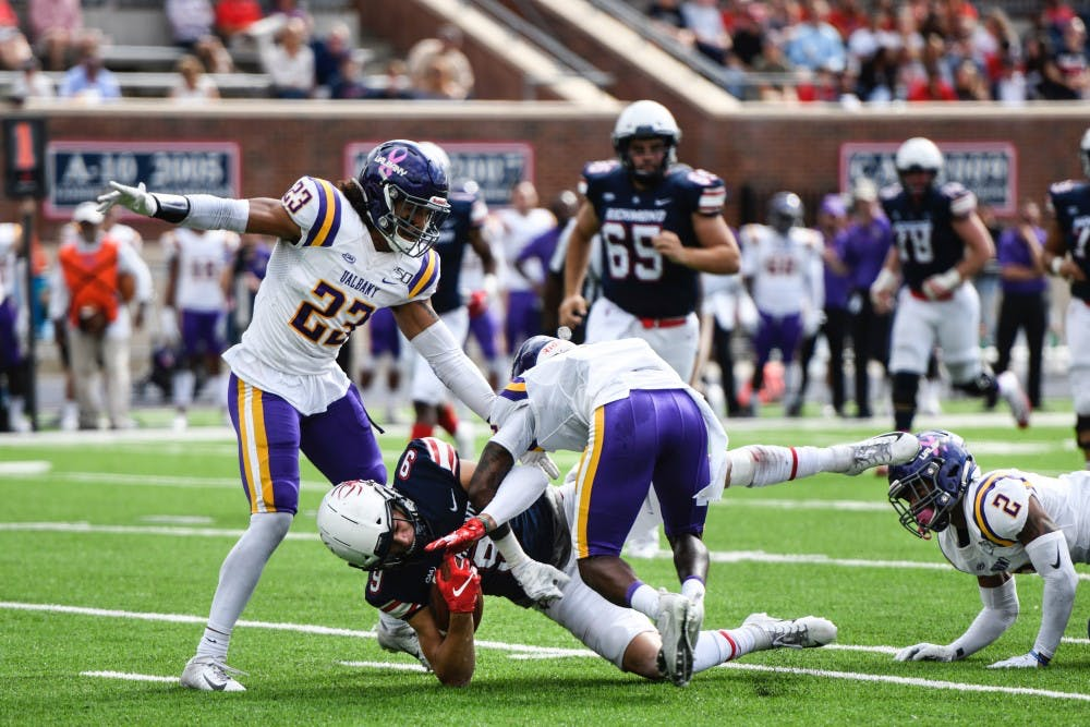 <p>Wide receiver graduate student Charlie Fessler gets tackled by Albany's defense during the October 5th game at Robins Stadium.&nbsp;</p>