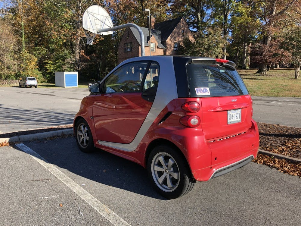 The Smart car driven on campus by the parking monitor.