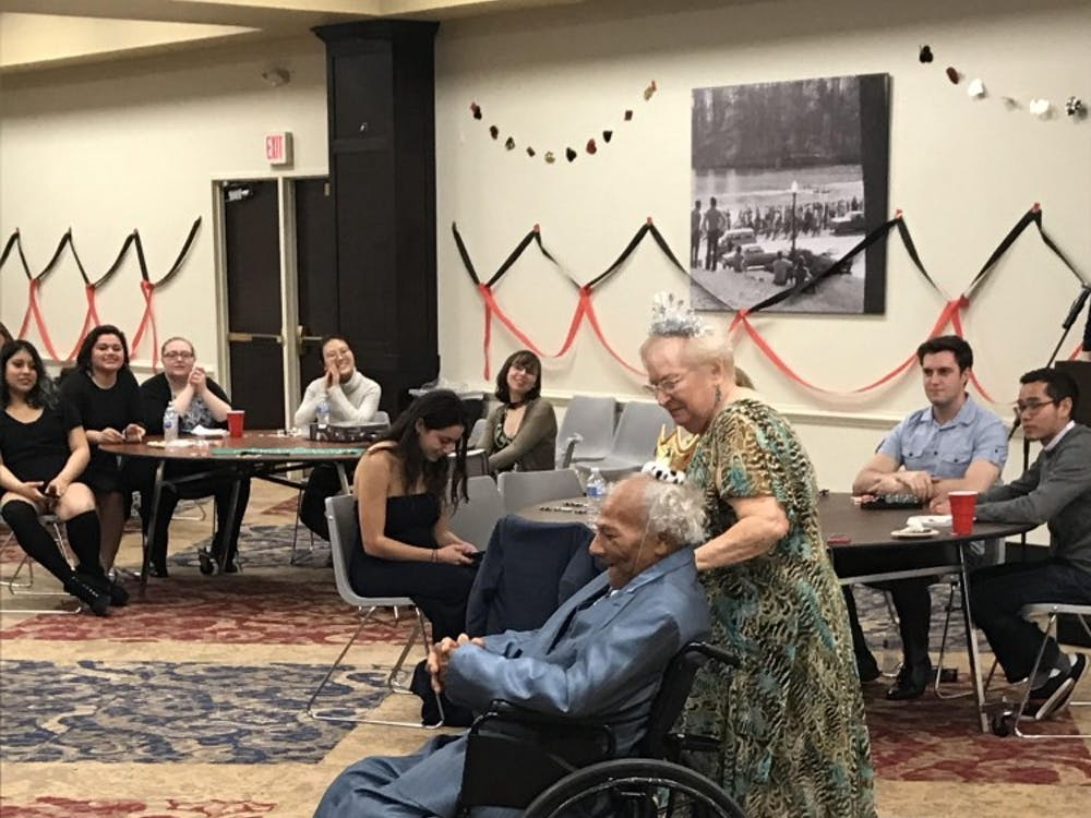 Two Richmond senior citizens dance together at a prom hosted by Alpha Phi Omega in the Alice Haynes Room.