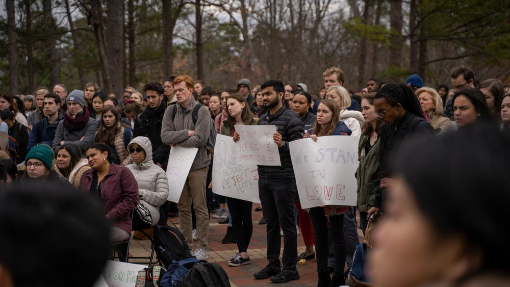 "<p>Students stand in the Forum at ""More Than Just a Message,"" an open mic protest aimed at denouncing racist actions that occur on campus. The event took place on Tuesday, Jan. 28, 2020.</p>"