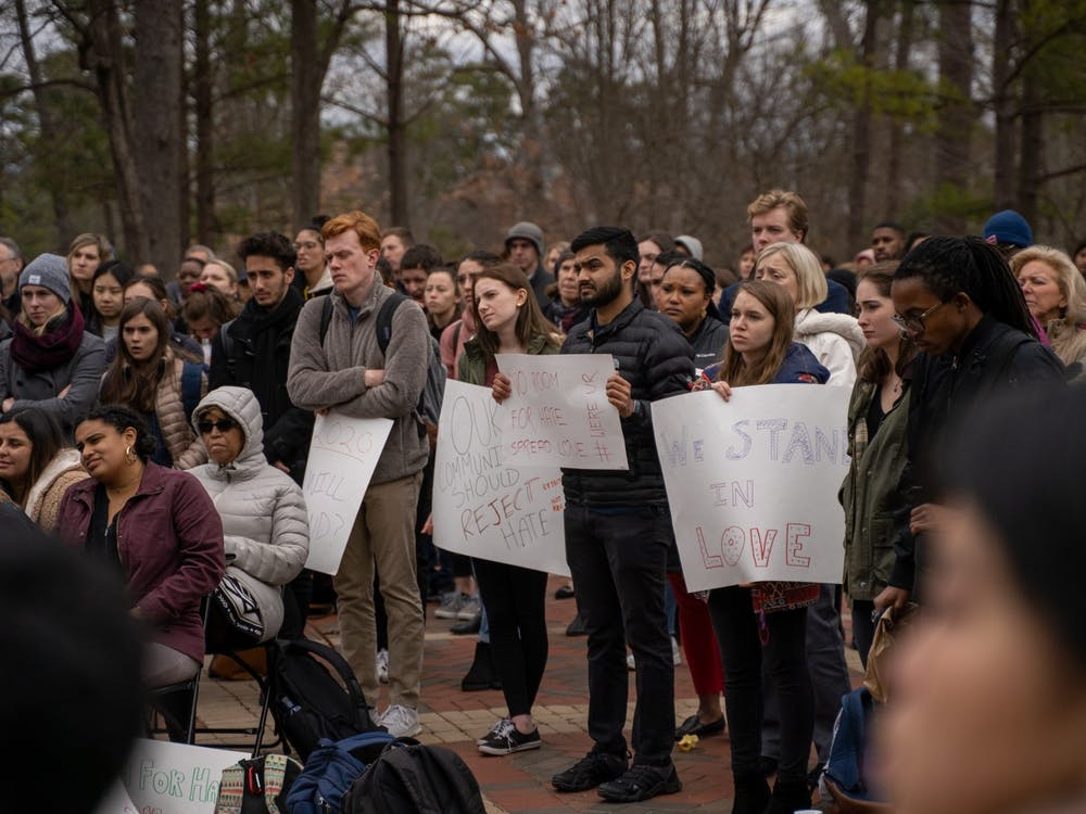 "Students stand in the Forum at ""More Than Just a Message,"" an open mic protest aimed at denouncing racist actions that occur on campus. The event took place on Tuesday, Jan. 28, 2020."