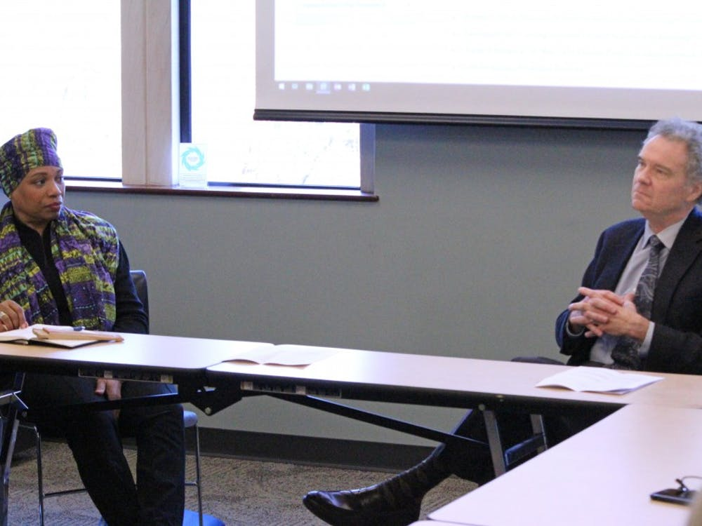 President Emeritus Edward Ayers, right, and Lauranett Lee, adjunct assistant professor at the Jepson School of Leadership Studies, left, speak at a talk on Martin Luther King Jr. Day.