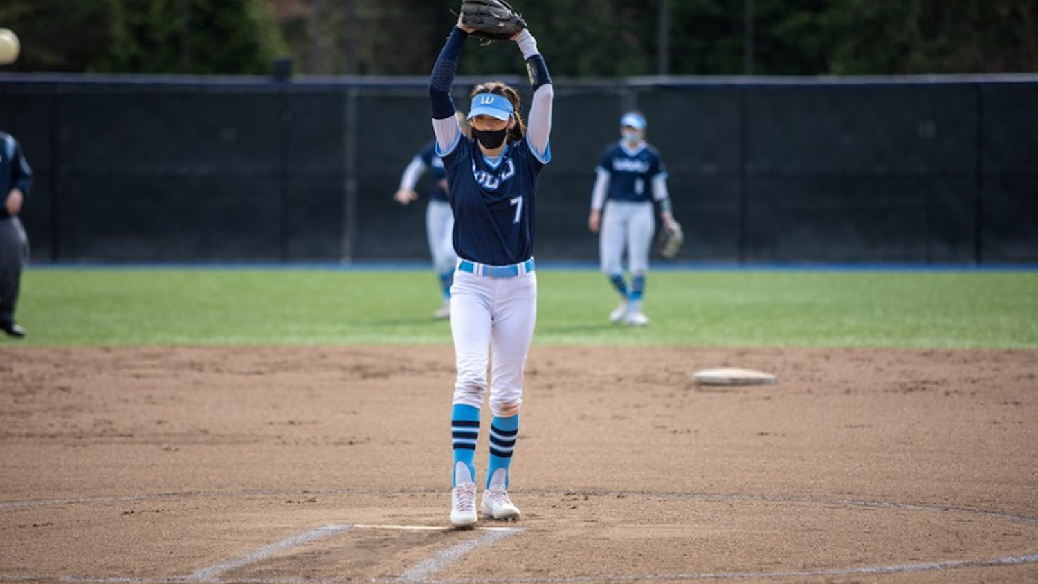 Senior Viking athlete Anna Kasner pitching in a game against Saint Martin's University on March 21, 2021. Kasner led Viking softball to win the 2021 GNAC Championship. // Photo courtesy of WWU Athletics