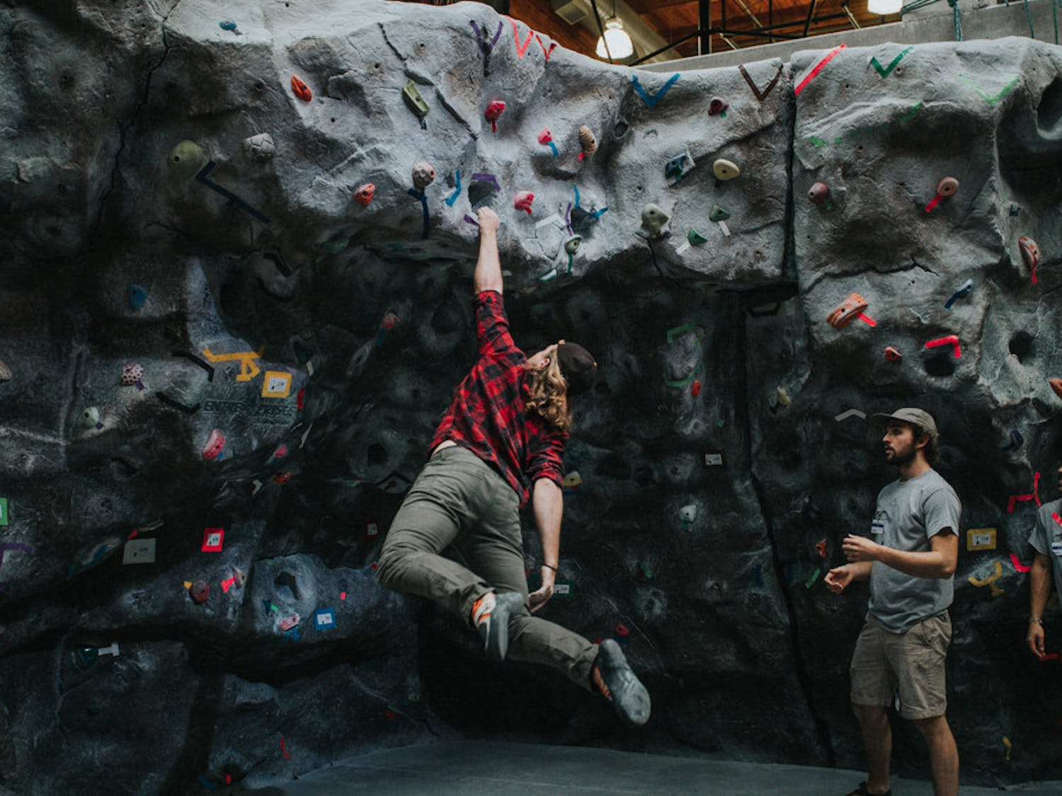 IMG_2204_Logan.Ian-use-from-last-year-during-our-Dyno-competition.-The-climber-is-unidentified-and-the-spotters-are-Veni-Vidi-Ascendi-staff-Ian-Dandridge-left-and-Logan-Fletcher-right