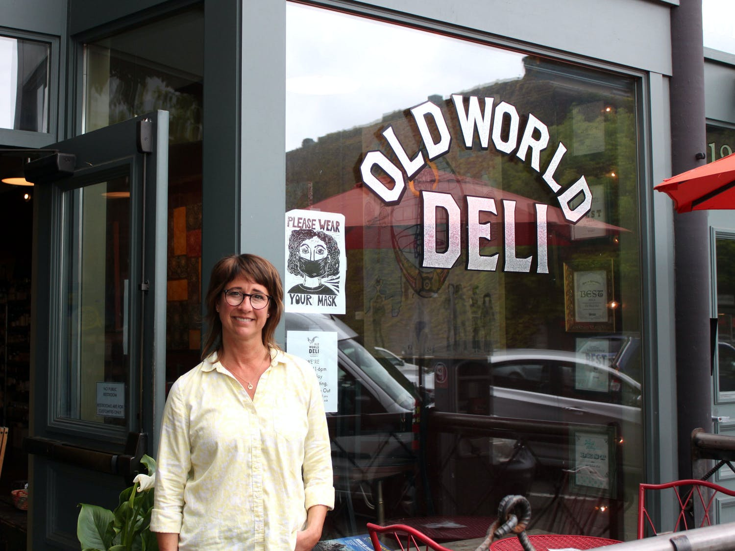 Anna Adams, owner of Old World Deli in Bellingham, Wash., stands outside the store's front window on Wednesday, May 26. If your business is going to survive, Adams said you have to be flexible and react to the changes and figure out creative solutions. // Photo by Cameron Baird