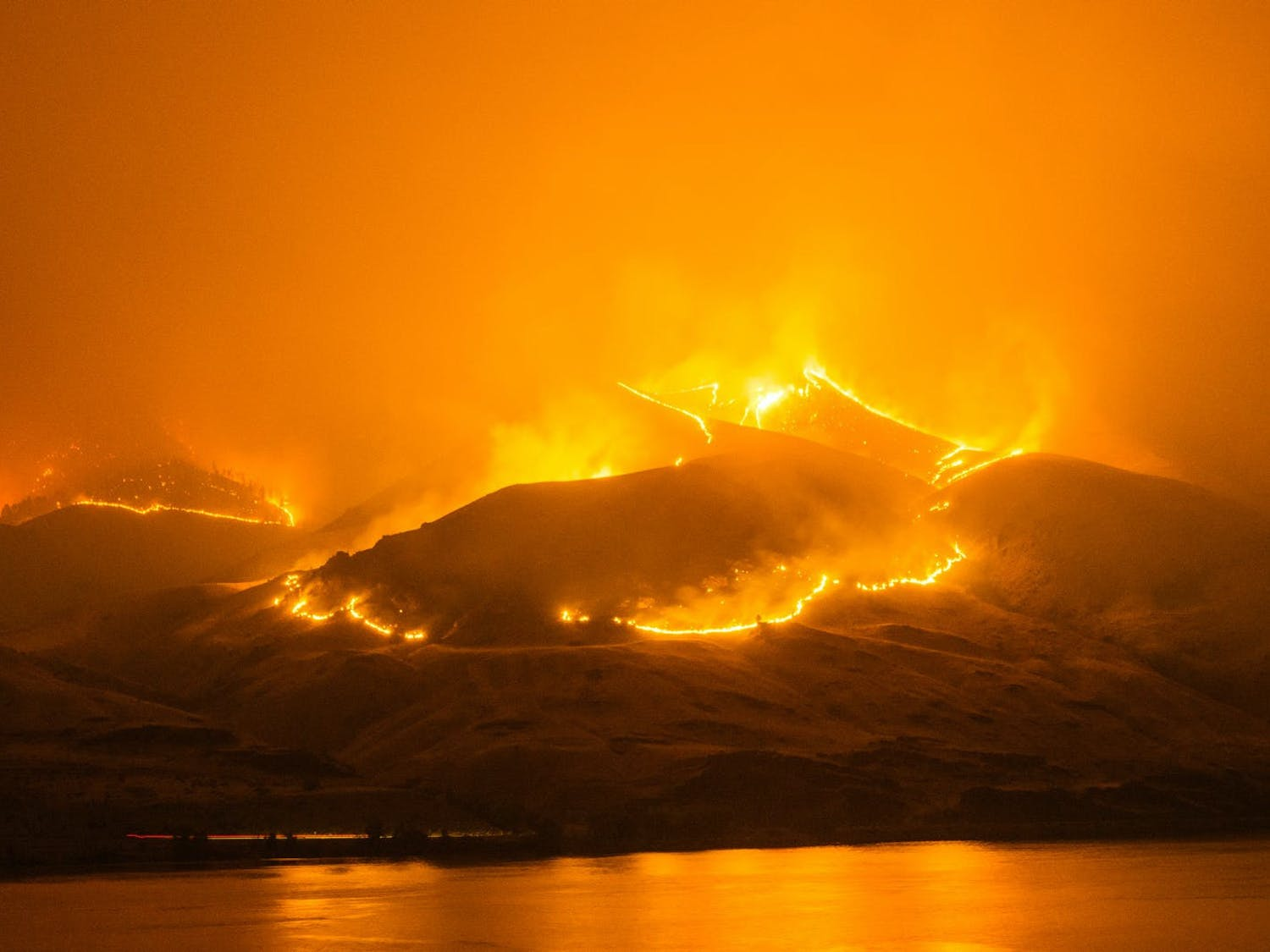 Wildfires running down the slopes of mountains near Orondo in 2014, just north of Wenatchee, Wash. Whatcom County officials remind residents that wildfires are just as possible on the wet side. // Photo courtesy of Frank Cone via Pexels