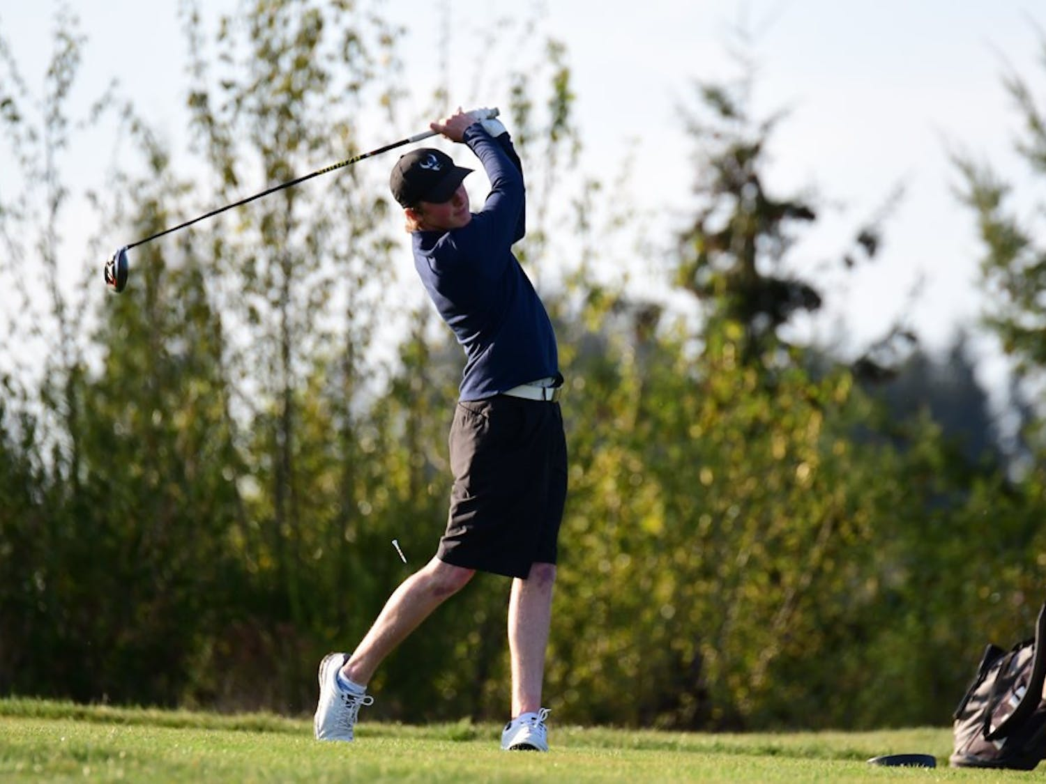 Freshman Viking Men's golfer Cody Oakes takes a swing off the tee at the Regional Division II competition. Oakes finished 20 over par after the three-day event. // Photo courtesy of Ron Smith