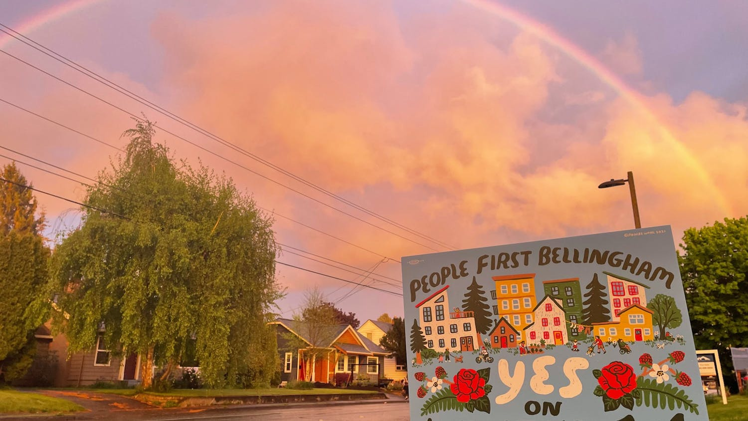 """A sign that reads """"People First Bellingham"""" underneath a rainbow on May 6, 2021, in Bellingham, Wash. People First Bellingham recently began campaigning for a slate of ballot initiatives for the November City of Bellingham ballot. // Photo courtesy of Sage Jones"""